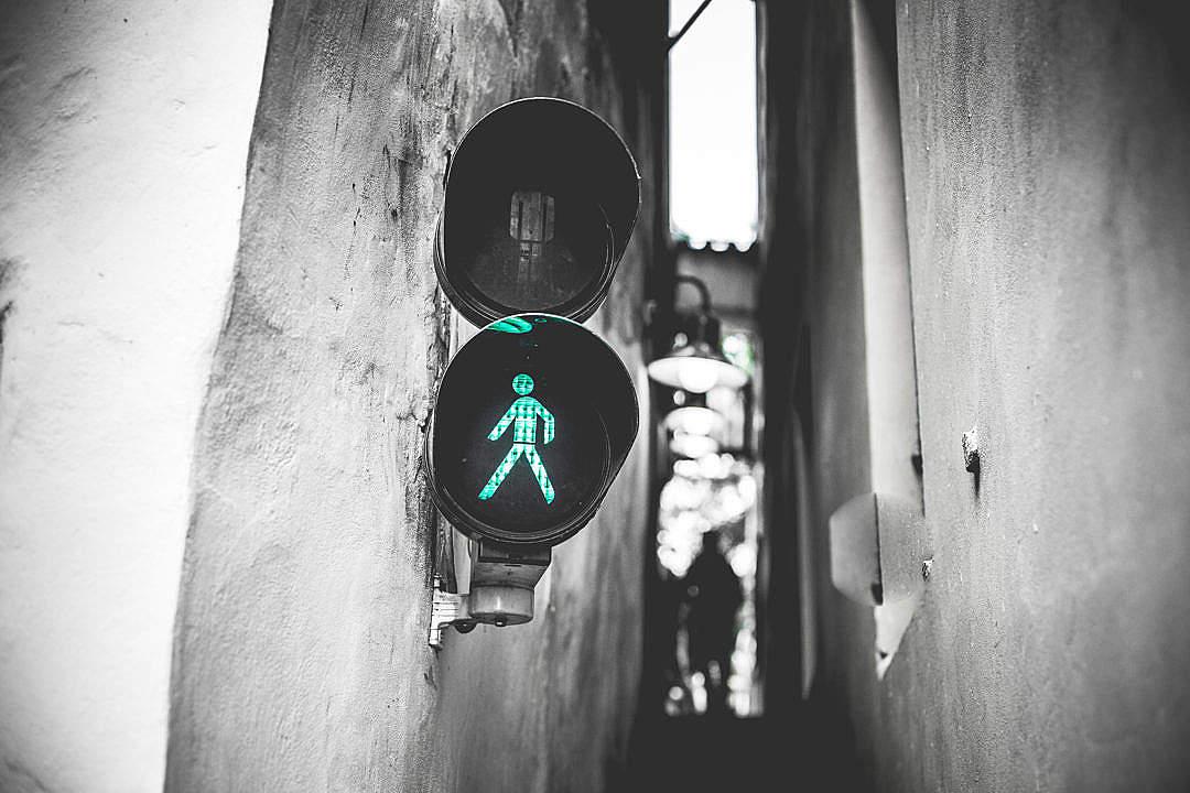 Download Green Traffic Light Walk Signal in Prague Narrowest Street FREE Stock Photo