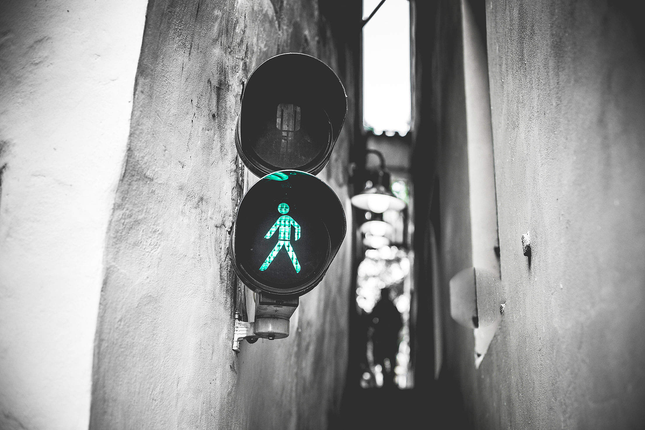 (click to download) Green Traffic Light Walk Signal in Prague Narrowest Street FREE Stock Photo