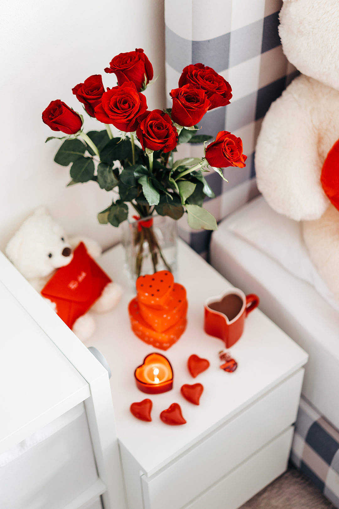 Download A Bouquet of Red Roses And Other Romantic Gifts on a Bedside Table FREE Stock Photo