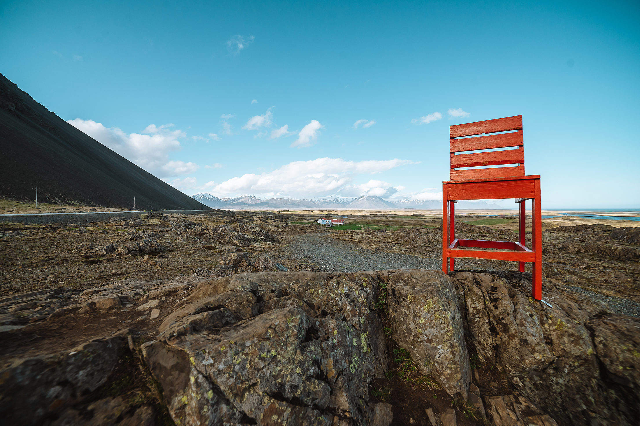 A Giant Red Chair Bolted to a Rock in Iceland Free Stock Photo