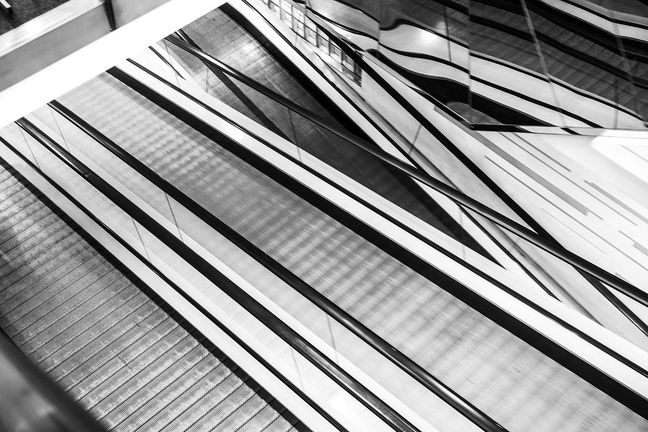 Abstract Black and White Geometric Background (Escalators) Free Stock Photo