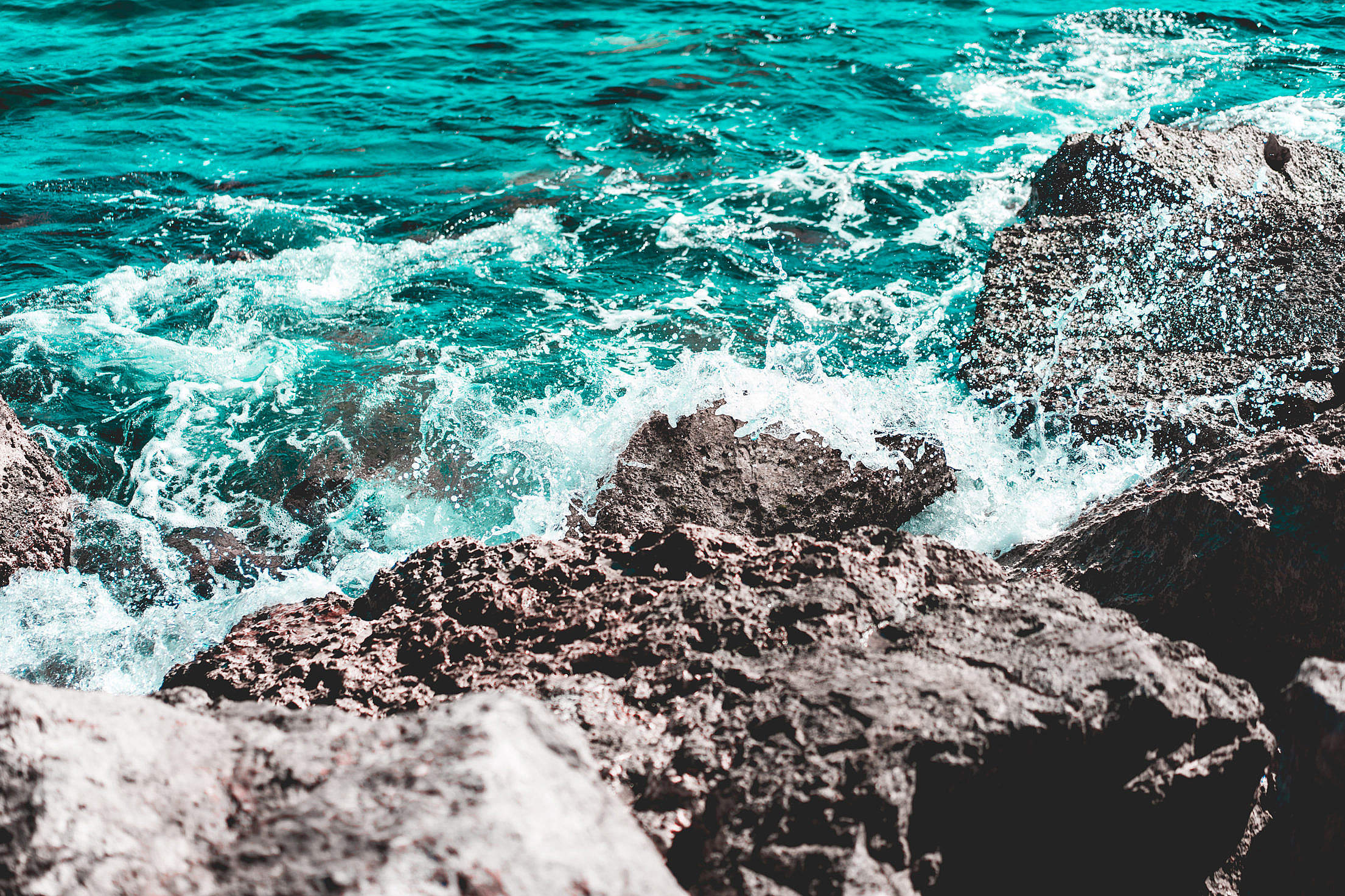 Abstract Infrared Photography of Sea Water Splash on the Rocks Free Stock Photo