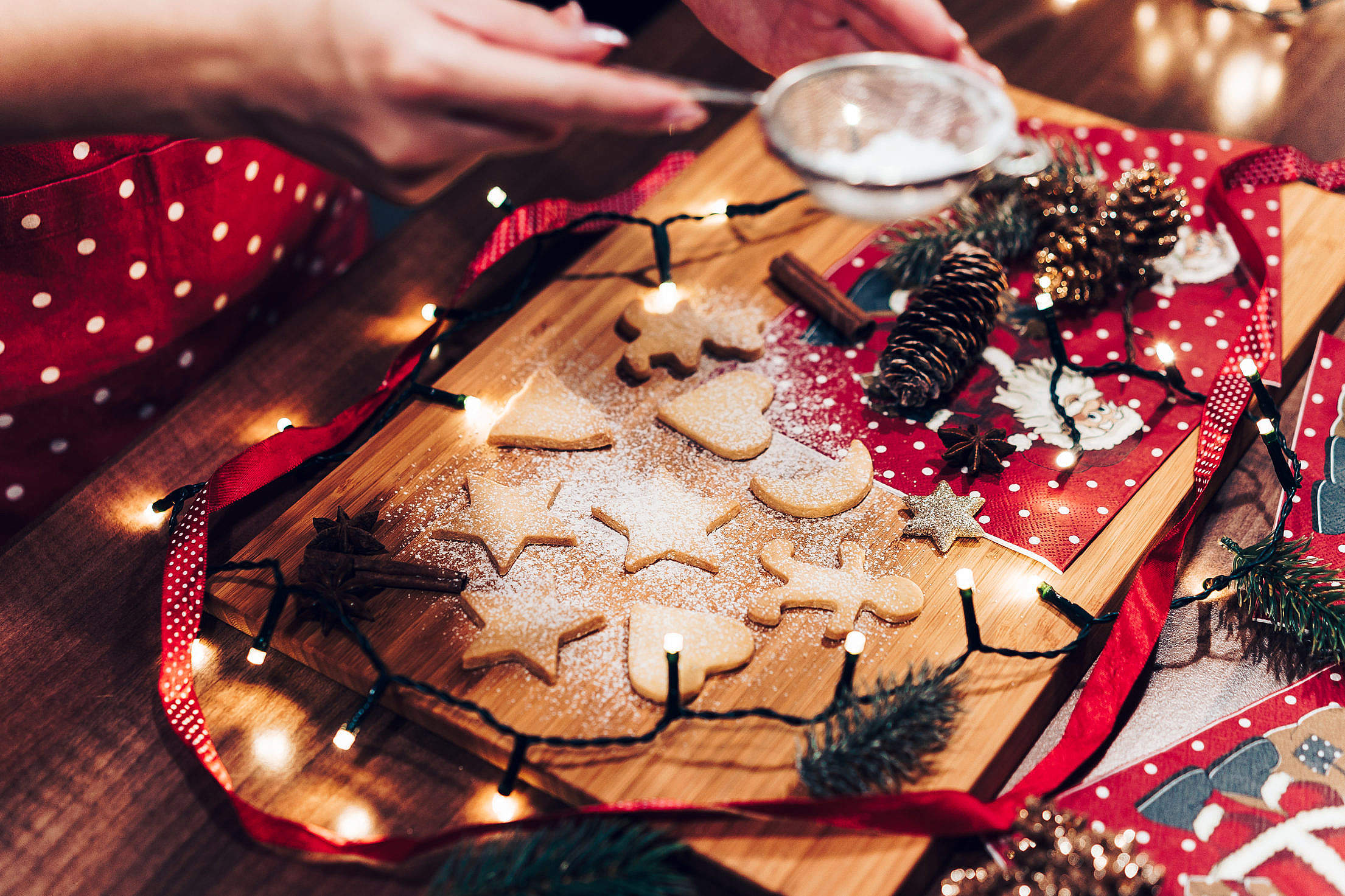 Adding Sugar on Christmas Cookies Free Stock Photo