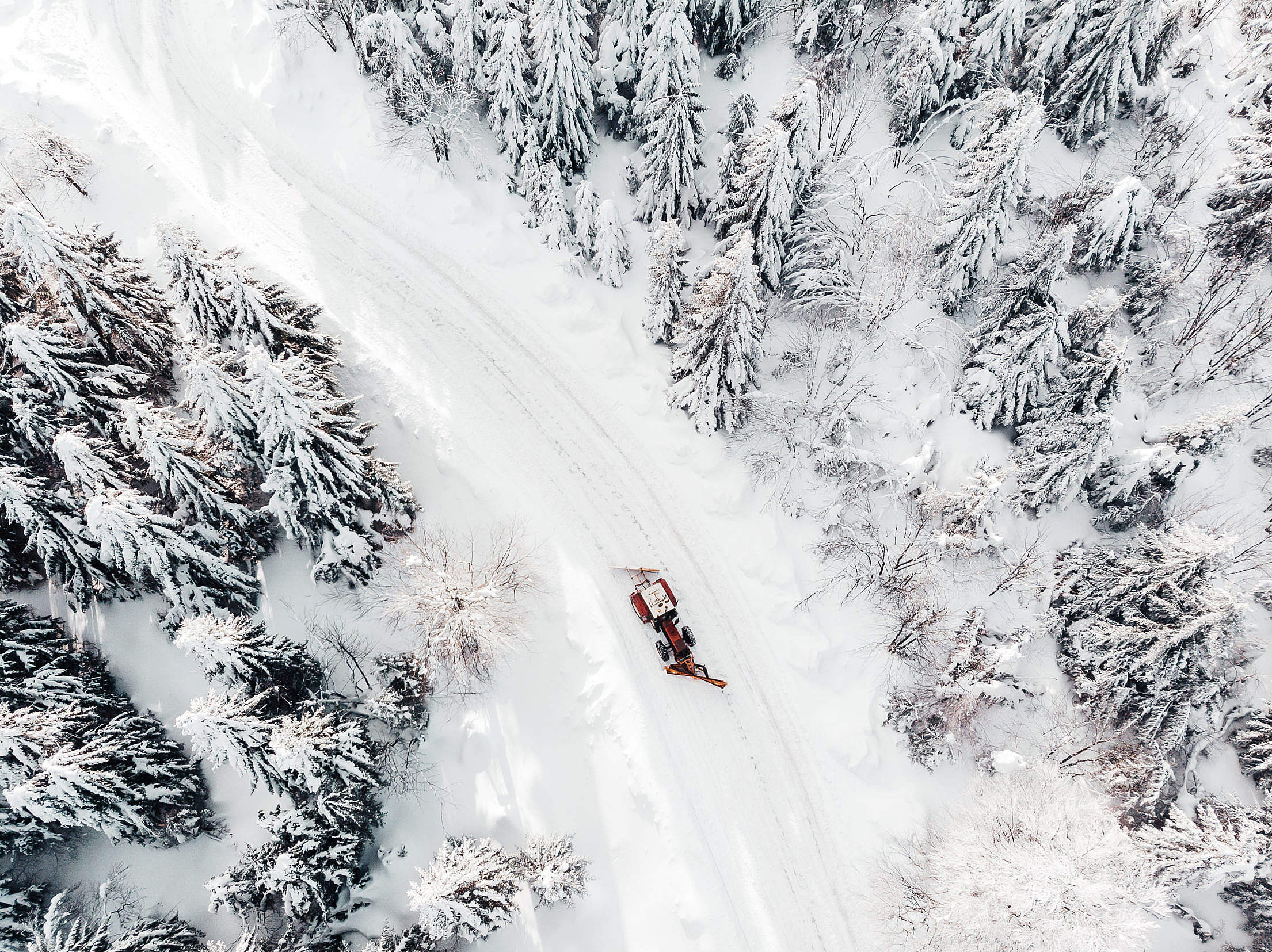 Aerial Drone Shot of a Snowy Road Free Stock Photo
