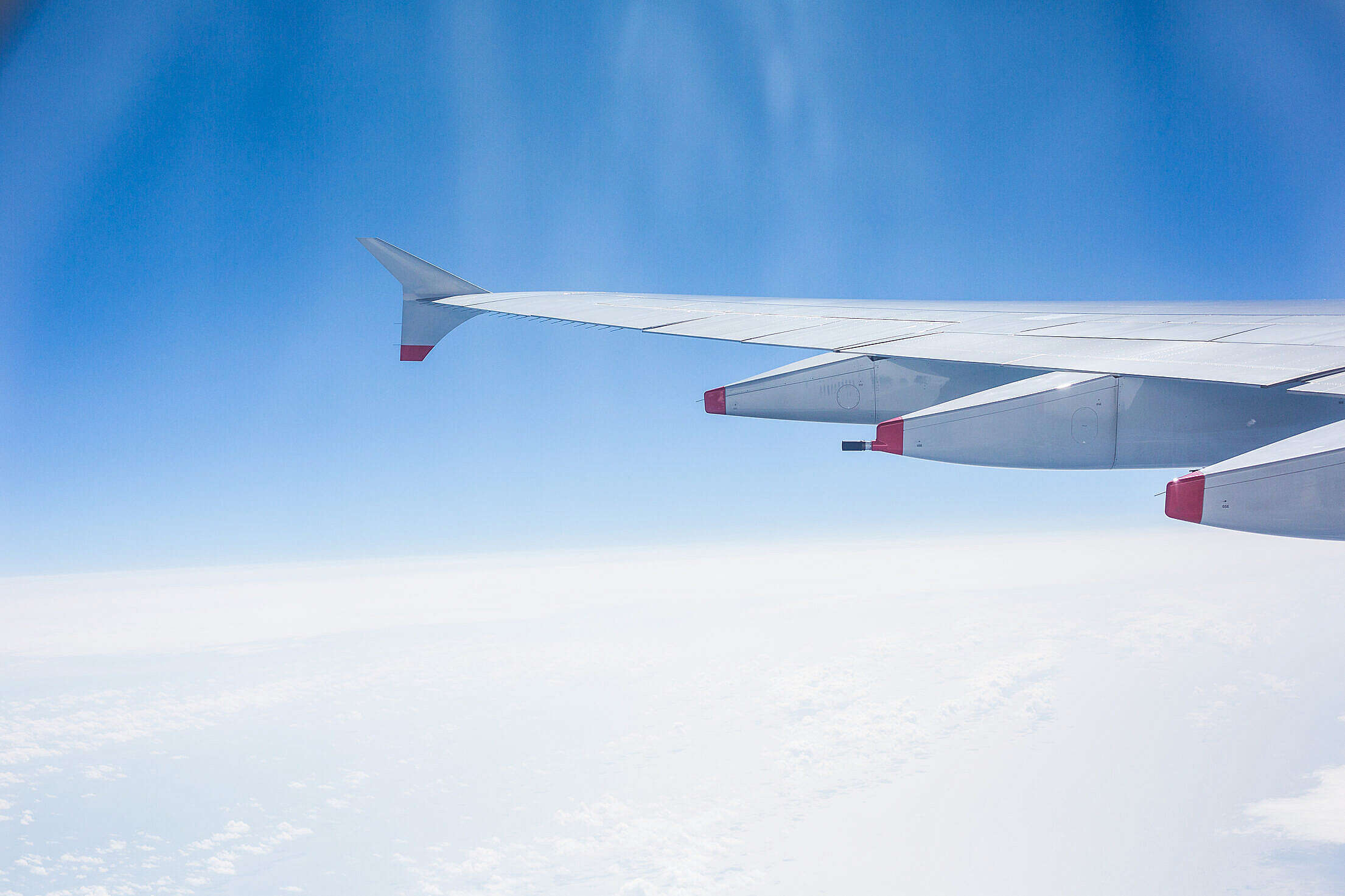 Airplane Wing and Cloudy Sky Free Stock Photo