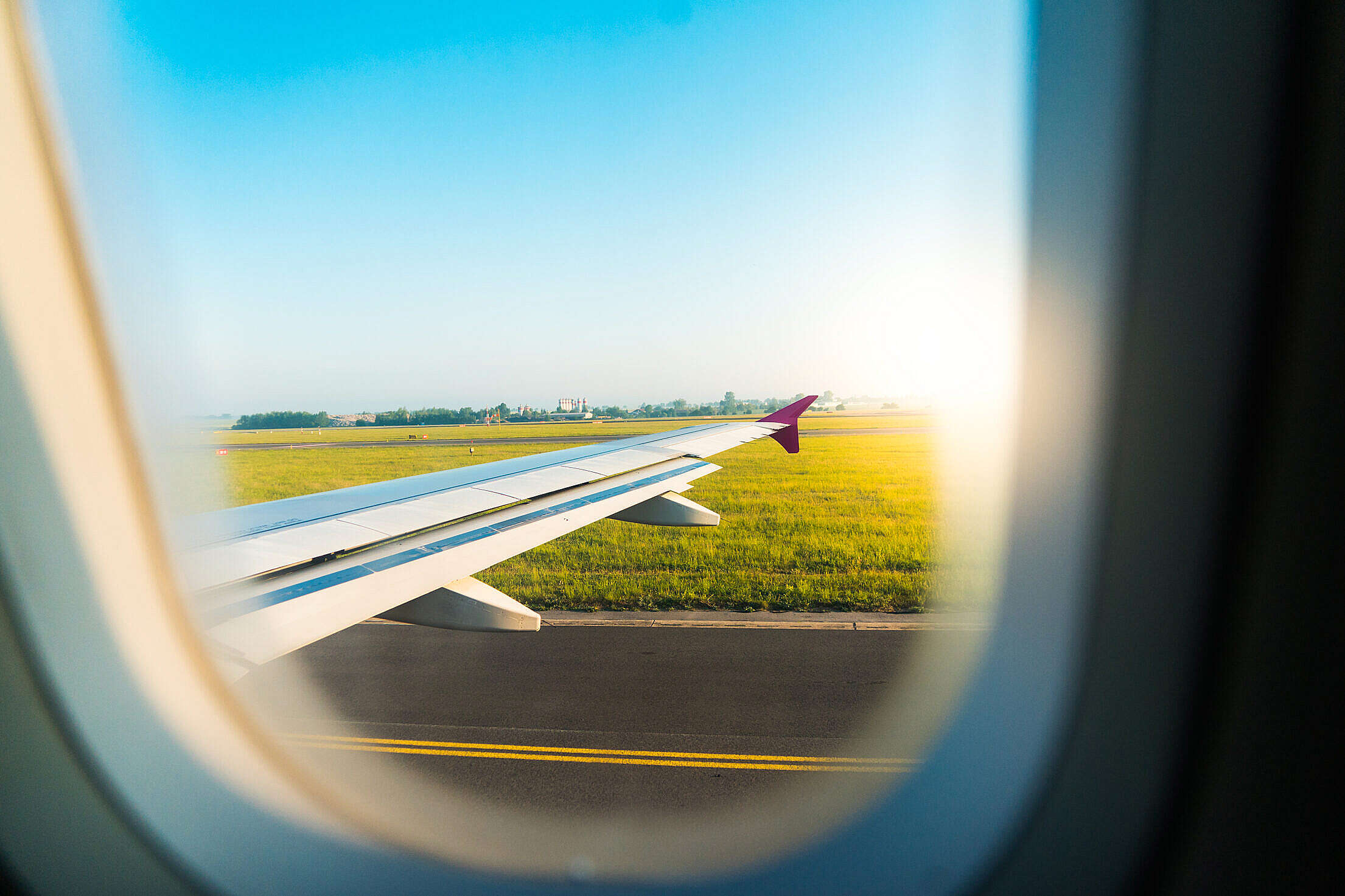 Airplane Wing Through Window During Take Off Free Stock Photo