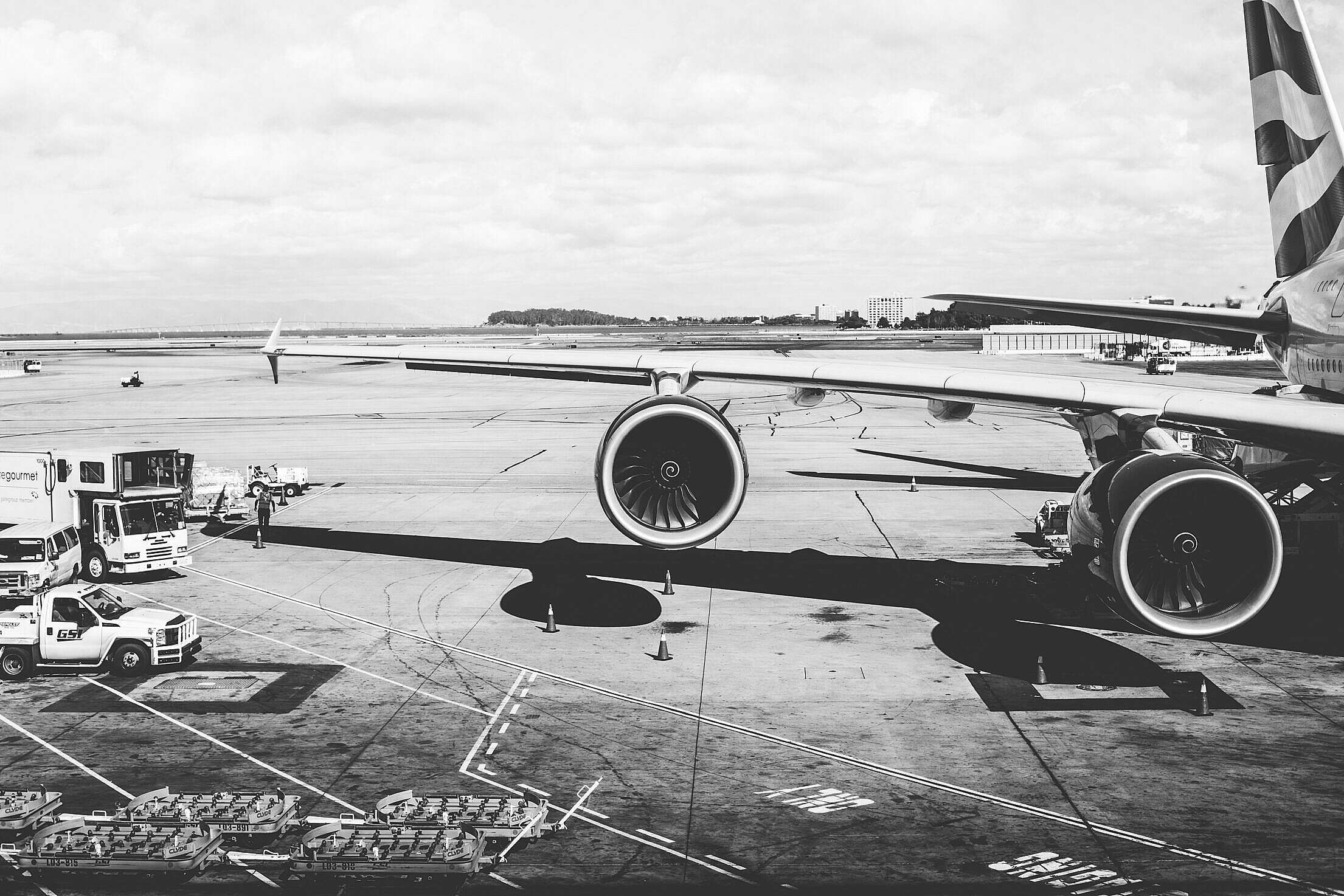 Airplane Wing with Jet Engines at the Airport Free Stock Photo