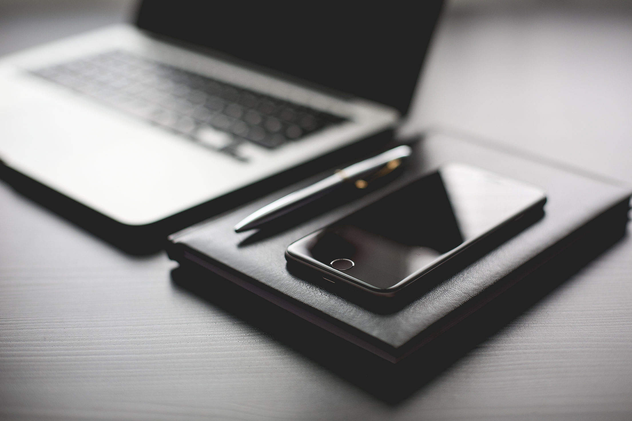 All Black Working Setup: Diary and iPhone Free Stock Photo