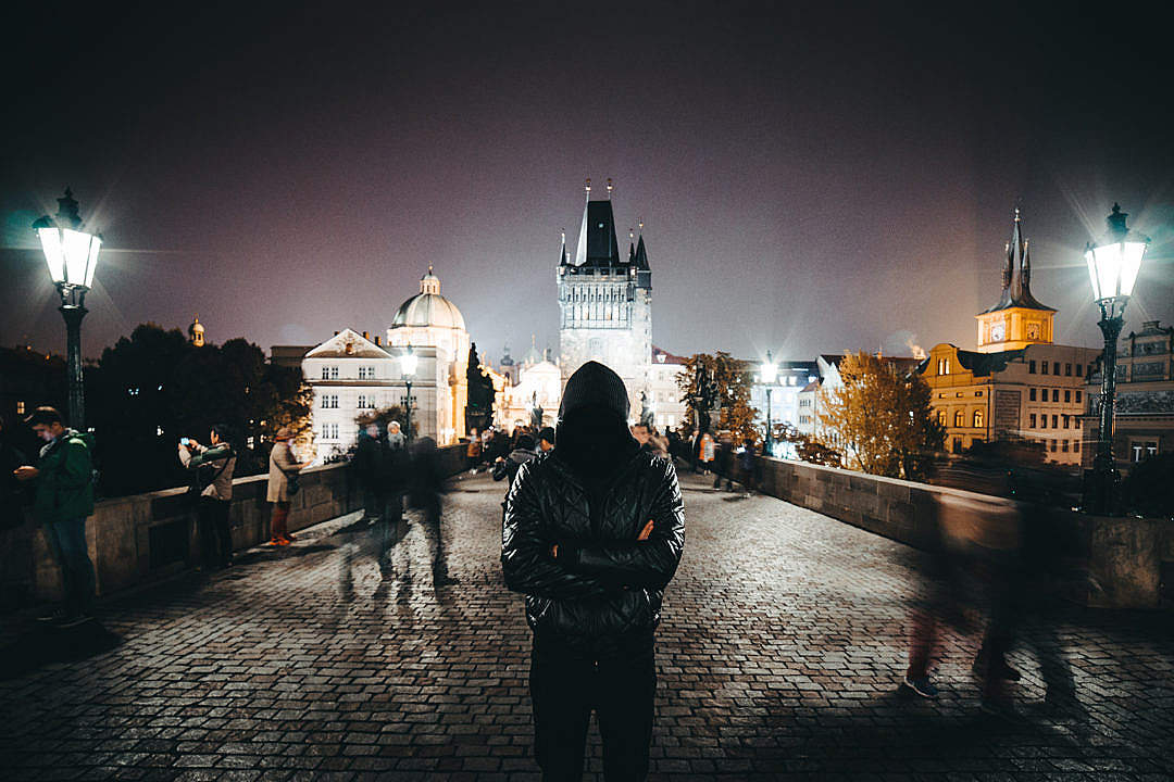 Download Anonymous Man with Crossed Arms Standing on Charles Bridge FREE Stock Photo