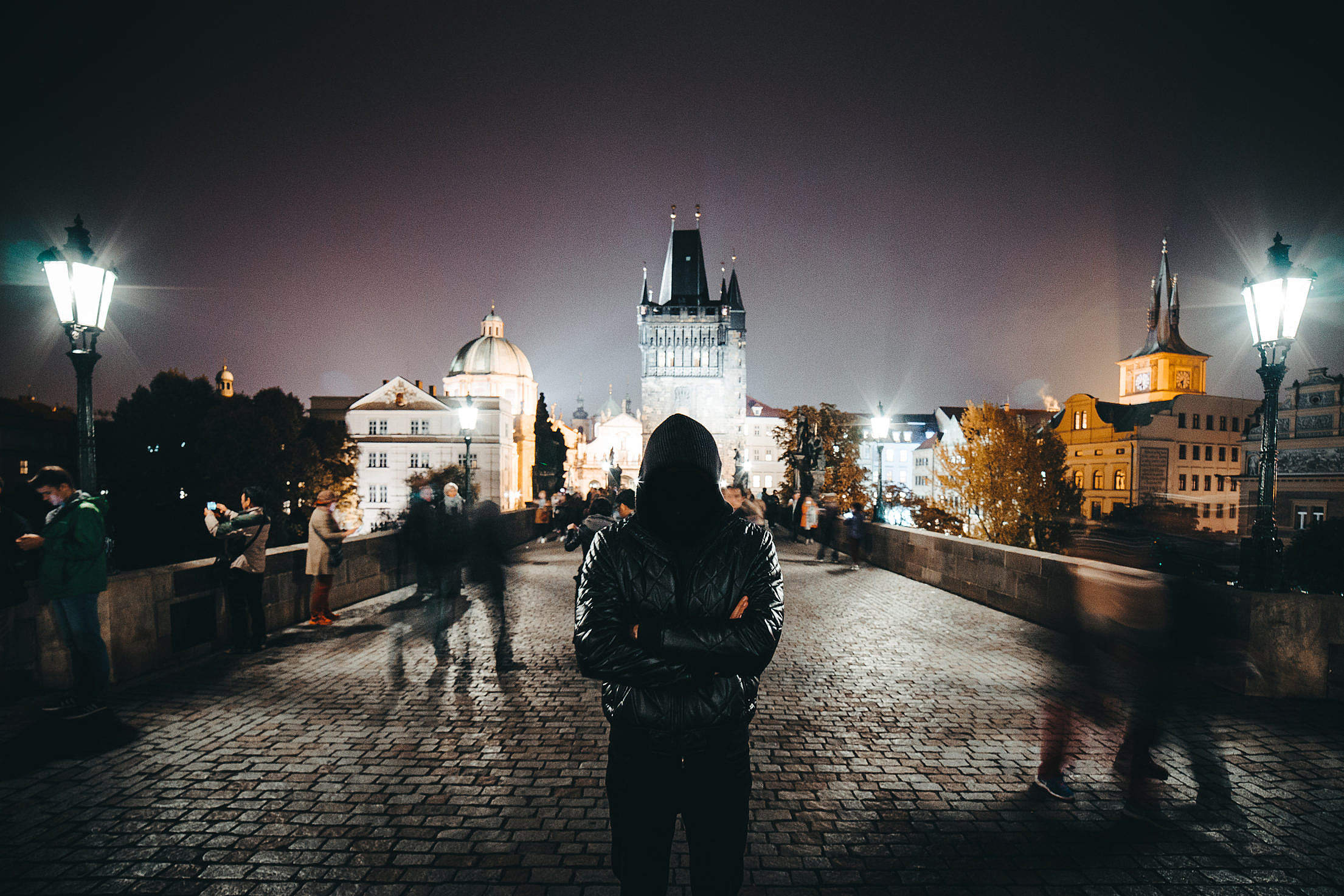 Anonymous Man with Crossed Arms Standing on Charles Bridge Free Stock Photo