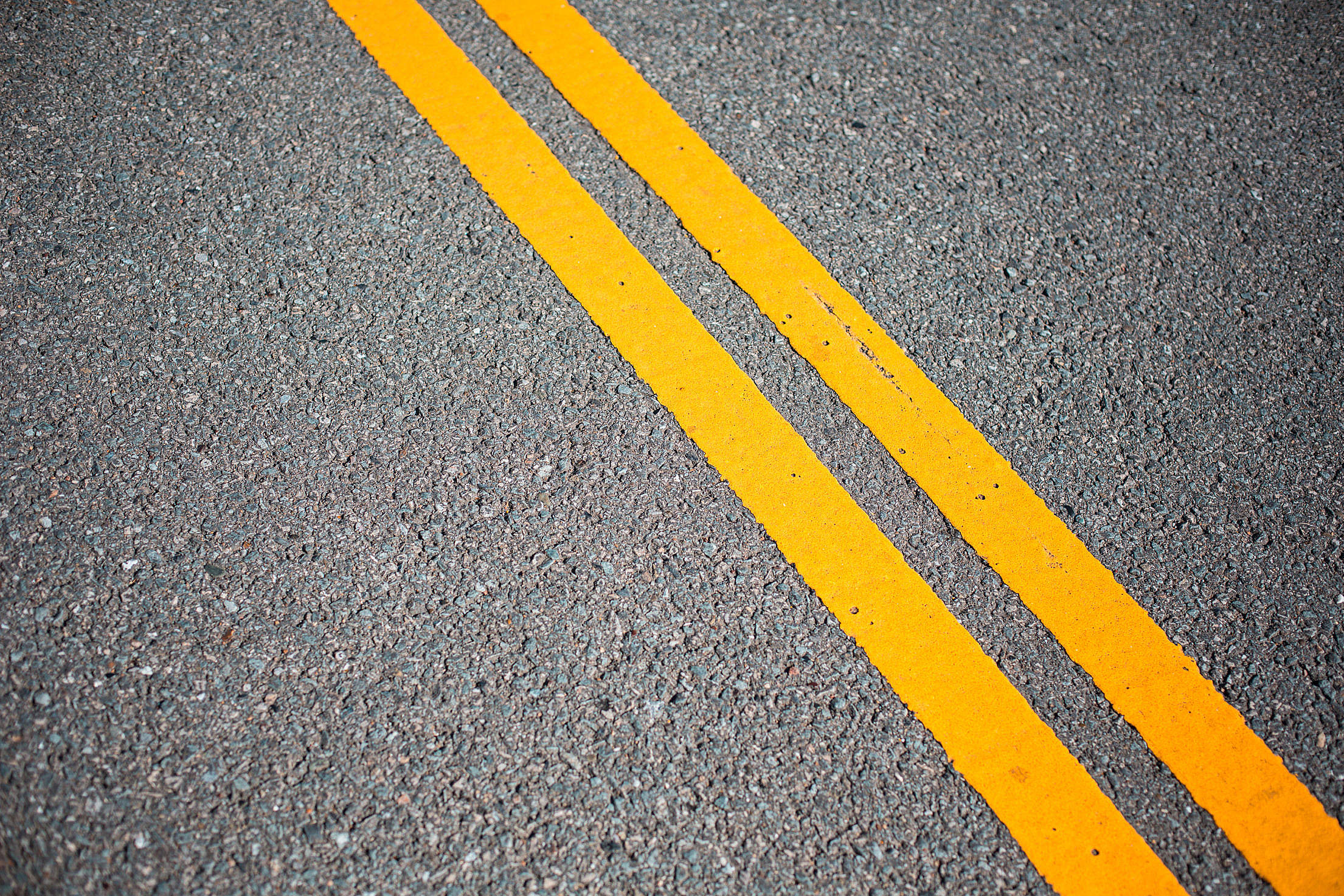 Asphalt Road with Yellow Road Lines Free Stock Photo