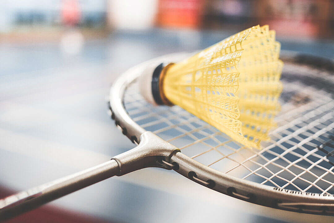 Download Badminton Racket and Yellow Shuttlecock Close Up FREE Stock Photo
