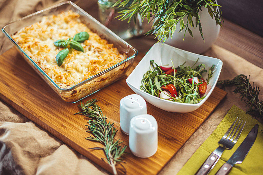 Download Baked Pasta with Tuna Served on a Wooden Chopping Board FREE Stock Photo