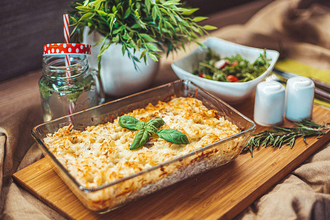Download Baked Tuna Pasta Served on a Wooden Plate FREE Stock Photo