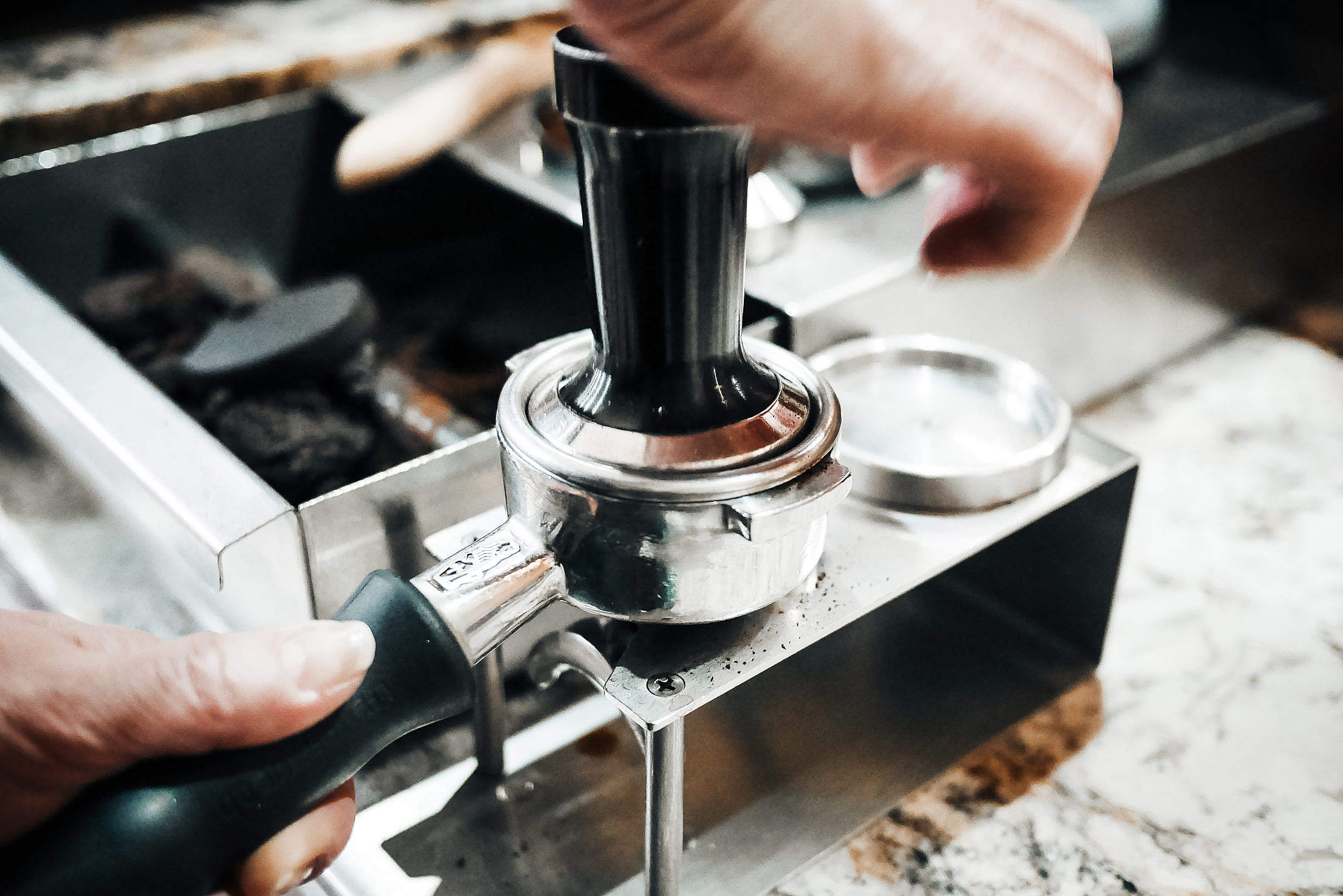 Barista is Pressing Ground Coffee in the Cafe Shop Free Stock Photo