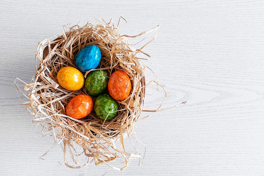 Download Basket Full of Easter Eggs FREE Stock Photo
