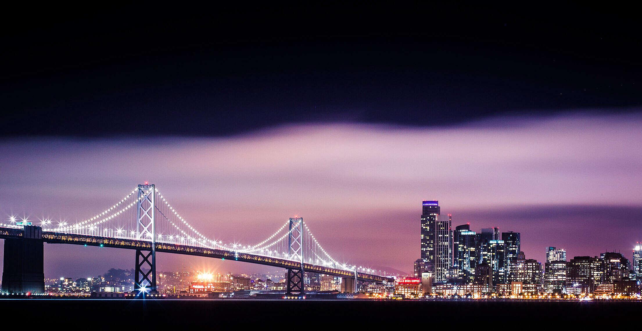 Bay Bridge with San Francisco Skyscrapers Cityscape at Night Free Stock Photo