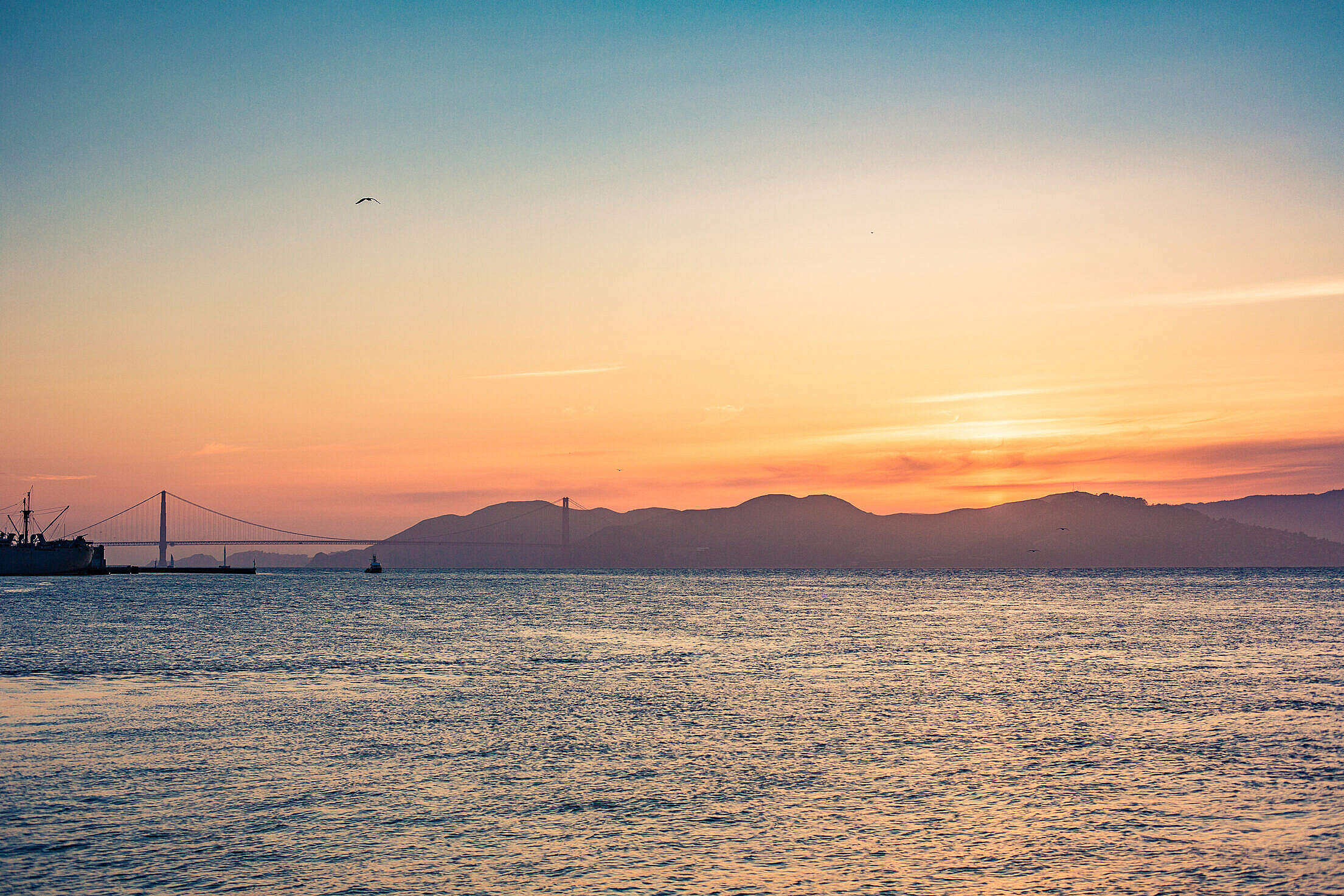 Beautiful Colorful Sunset with Ocean and Golden Gate Bridge Free Stock Photo