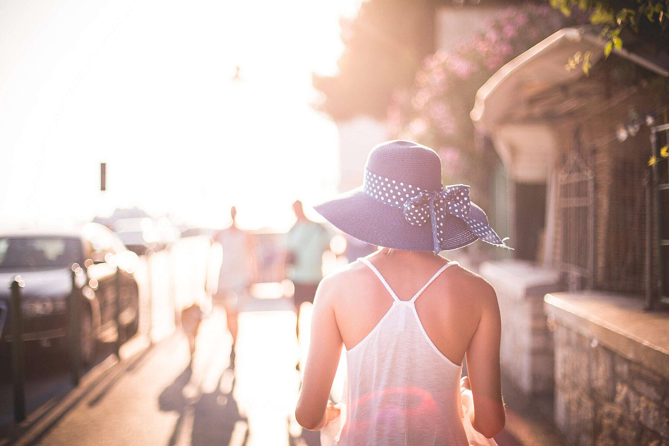 Beautiful Girl with Hat in Sun Free Stock Photo