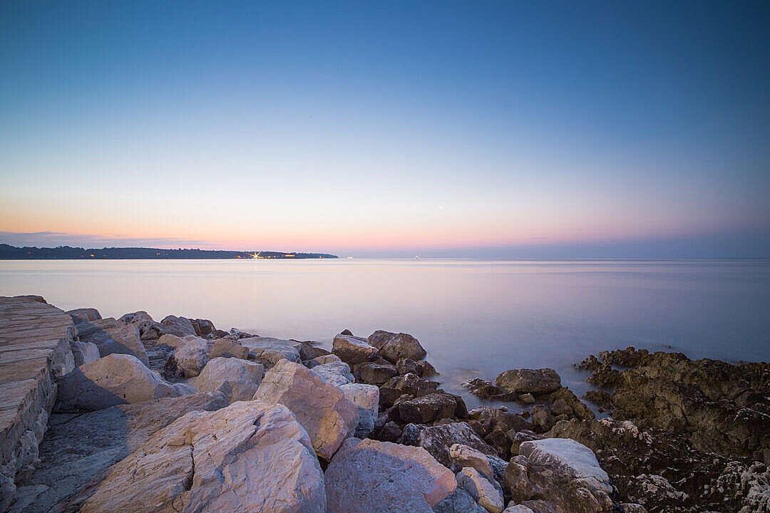 Download Beautiful Sunset Over Seaside Rocks FREE Stock Photo
