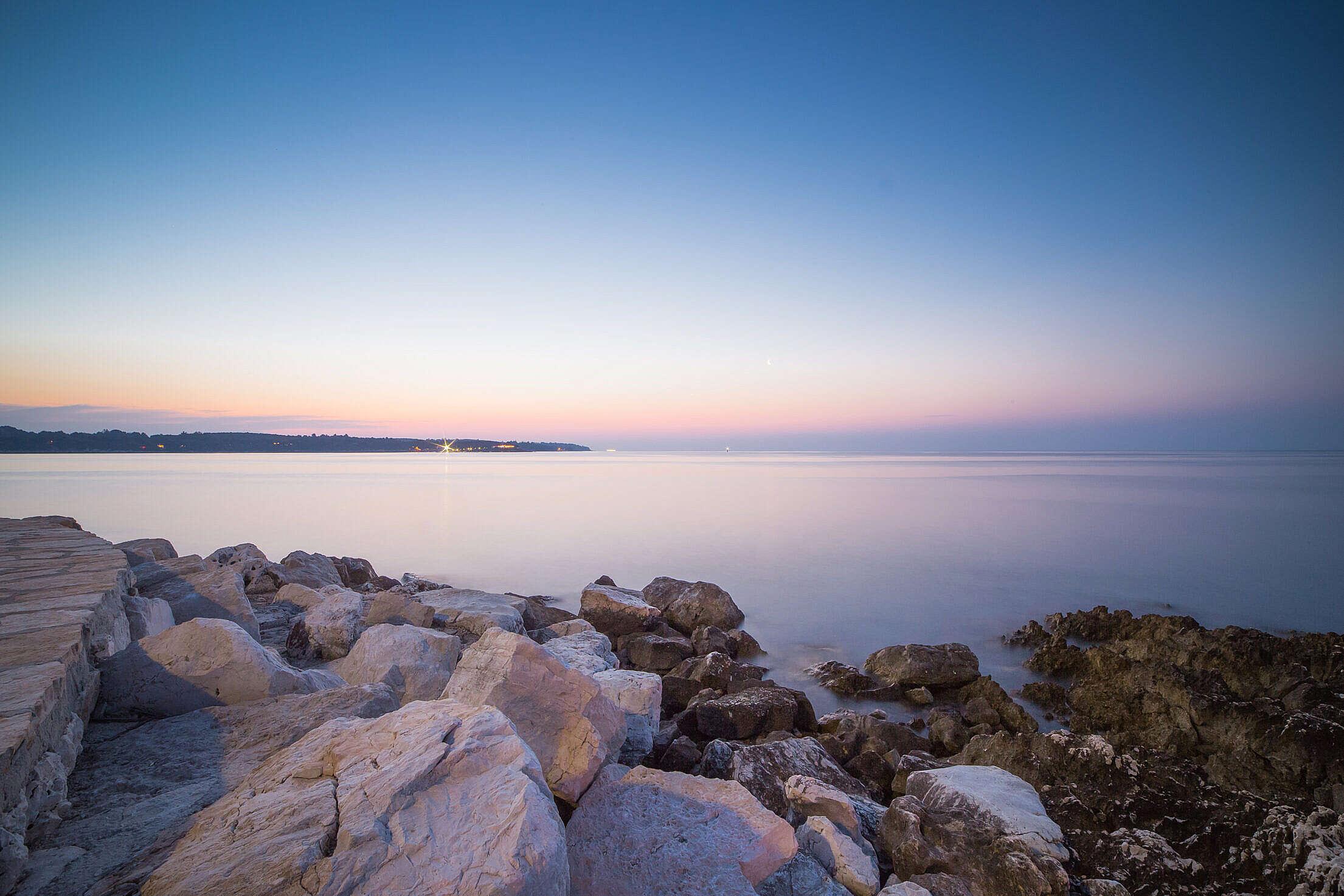 Beautiful Sunset Over Seaside Rocks Free Stock Photo
