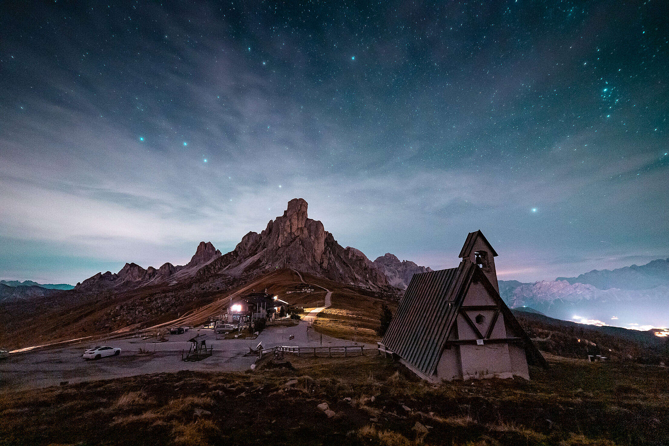 Beautiful View of a Church and a Rock Under a Night Sky Free Stock Photo