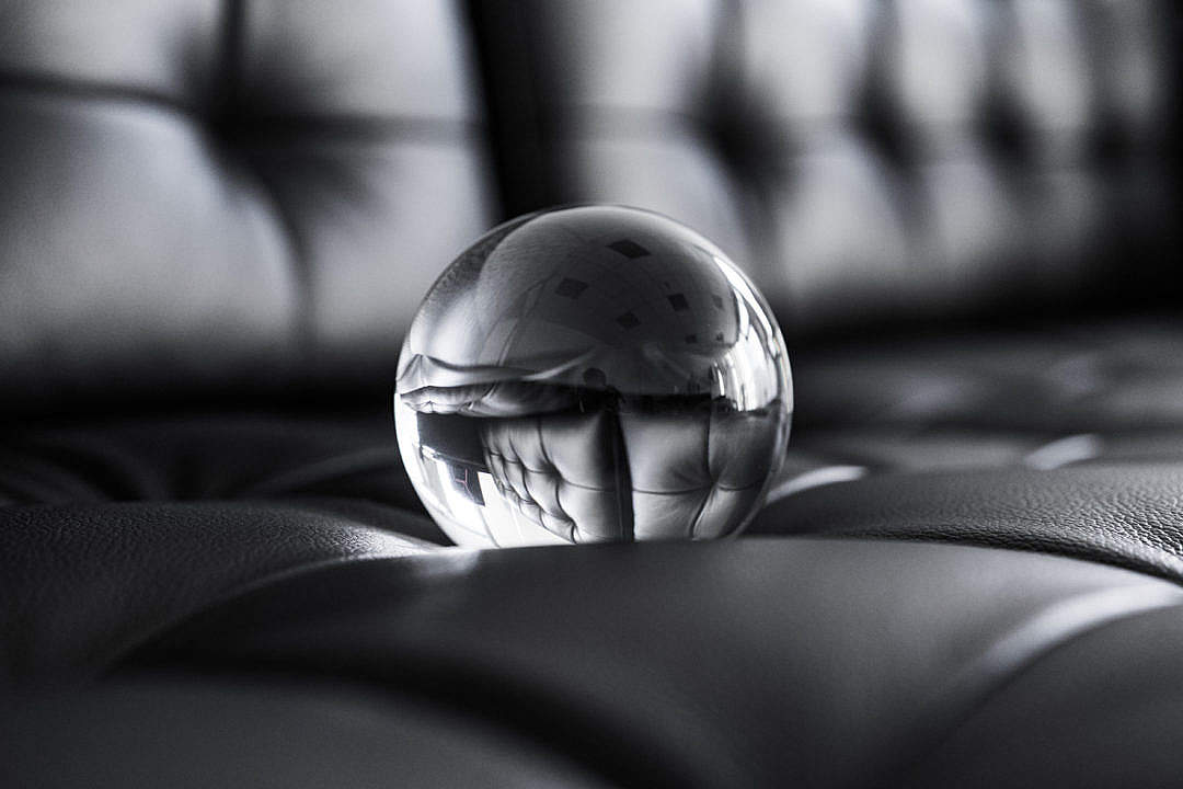Download Big Glass Crystal Ball on Black Leather Sofa FREE Stock Photo