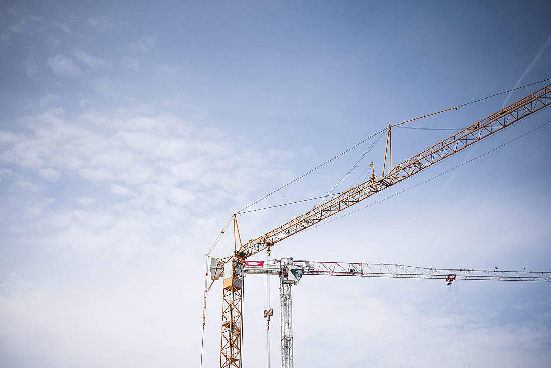 Download Big Lifting Cranes at Construction Site FREE Stock Photo