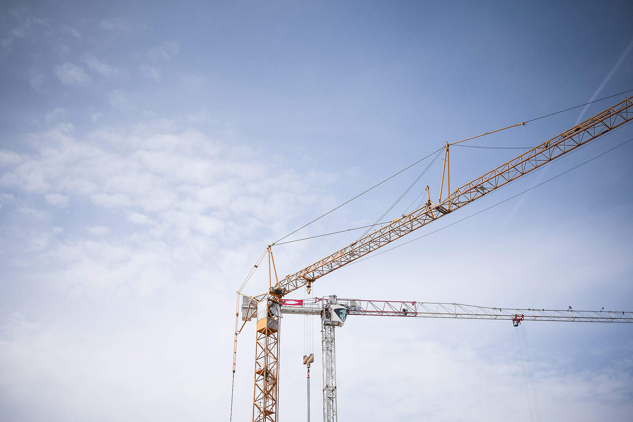 Big Lifting Cranes at Construction Site Free Stock Photo