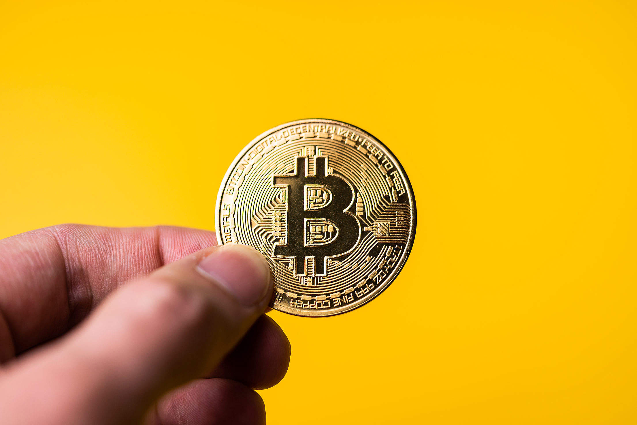 Bitcoin Golden Coin on Yellow Background Free Stock Photo