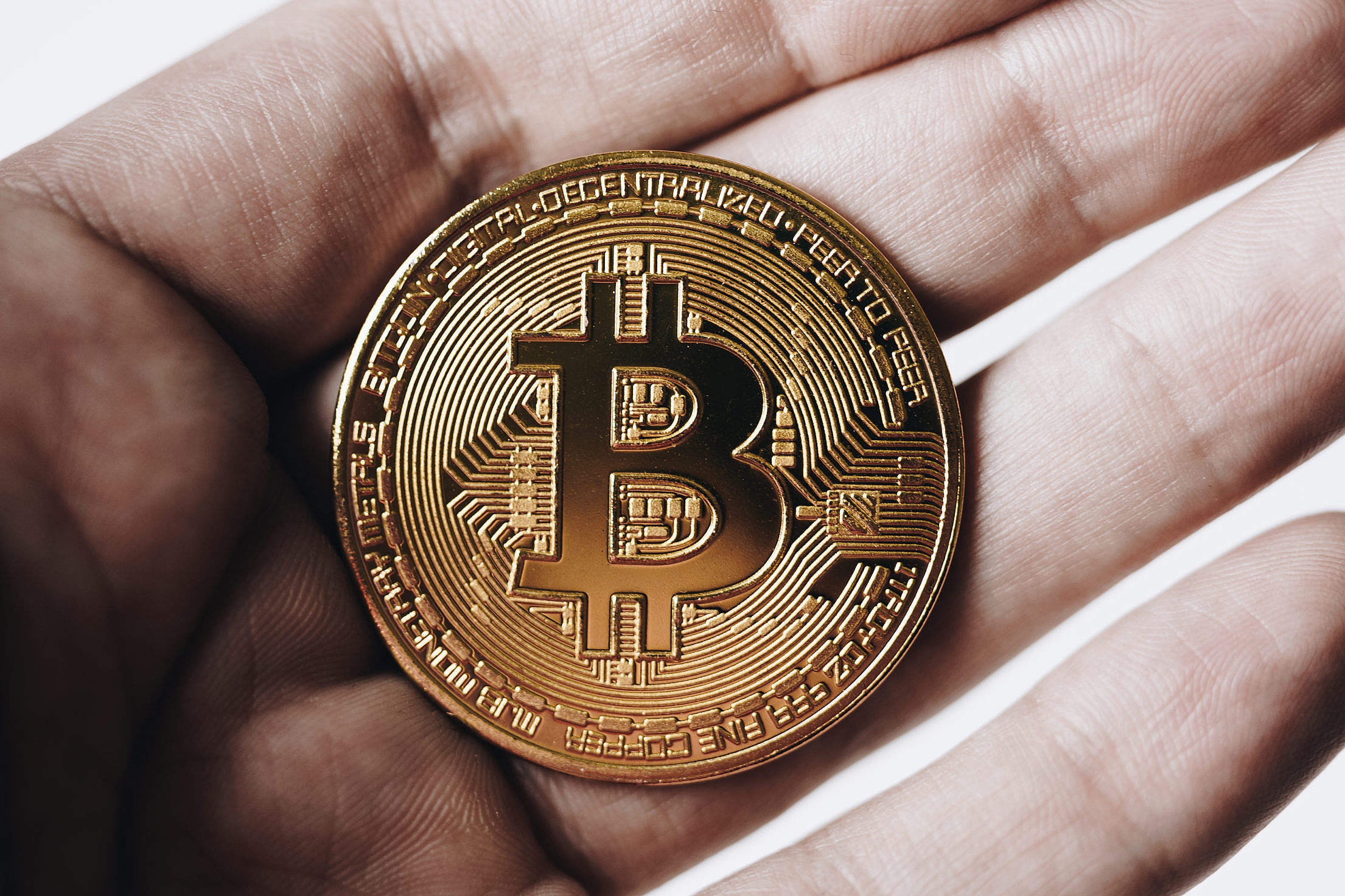 Bitcoin in Hand Free Stock Photo