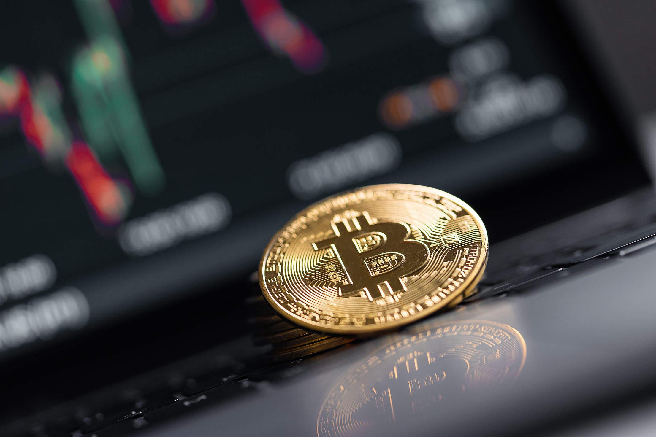 Bitcoin Reflection on a Laptop Gloss Free Stock Photo