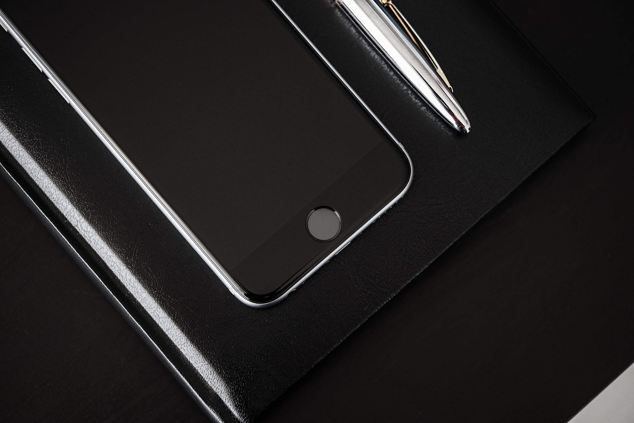 Black Desk, Black Diary, Black Smartphone Free Stock Photo