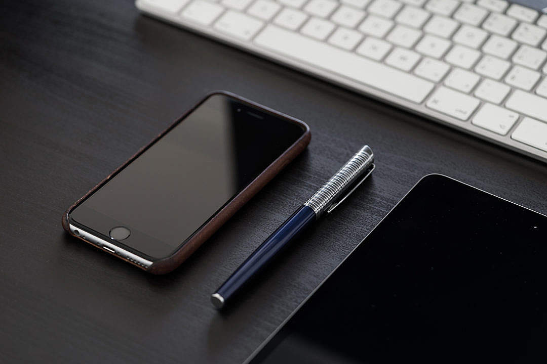 Download Black iPhone on Black Office Desk FREE Stock Photo