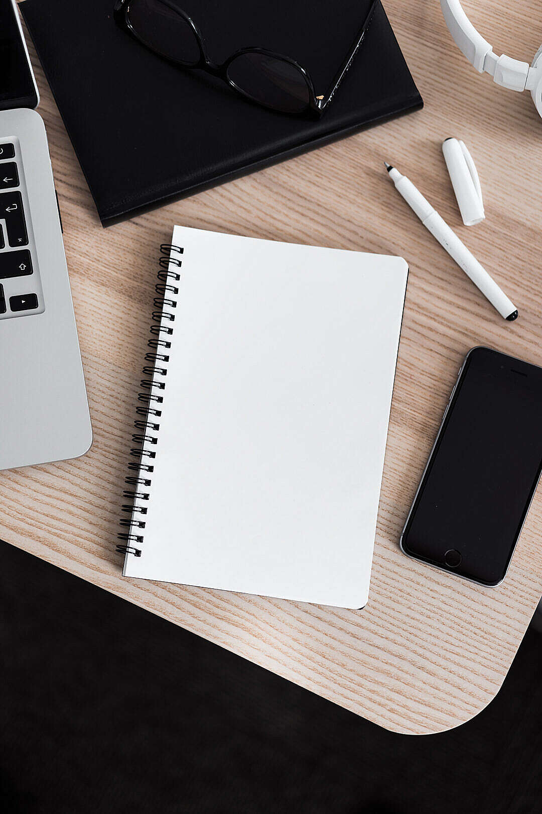 Download Blank Notebook in an Office Space FREE Stock Photo