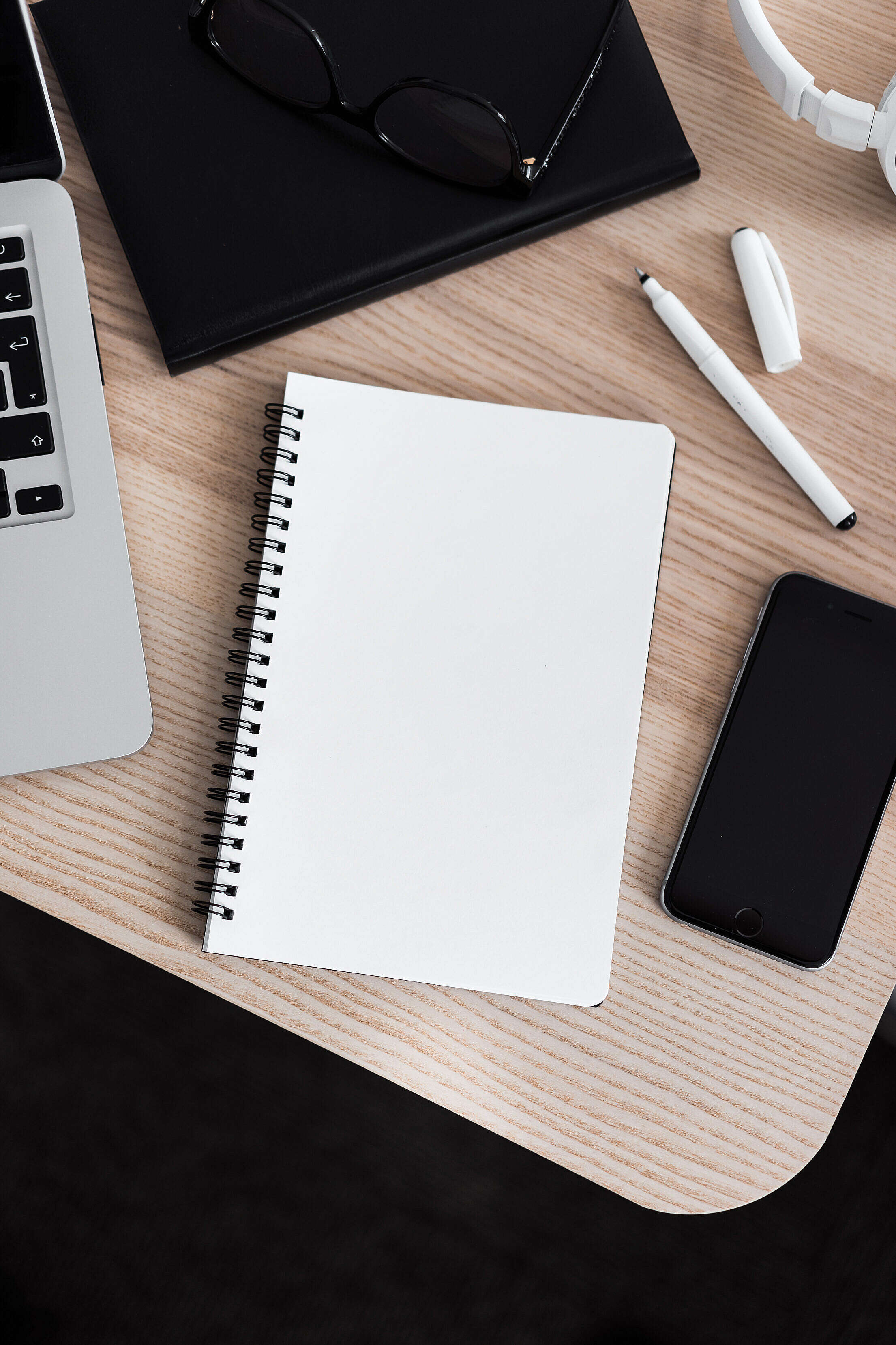 Blank Notebook in an Office Space Free Stock Photo