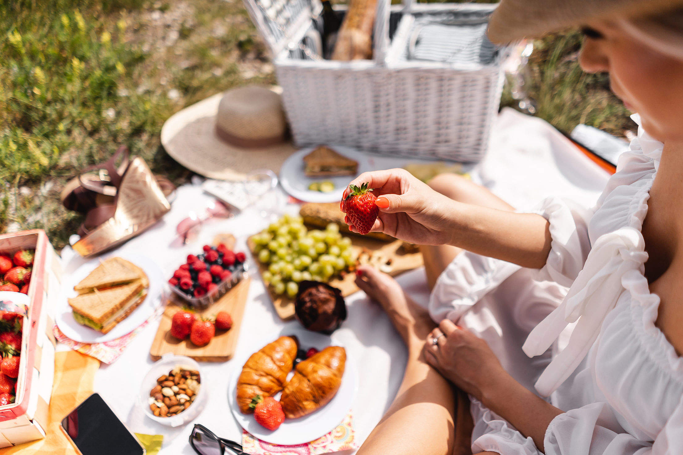 Blanket with Food Prepared for Summer Picnic Outdoors Free Stock Photo