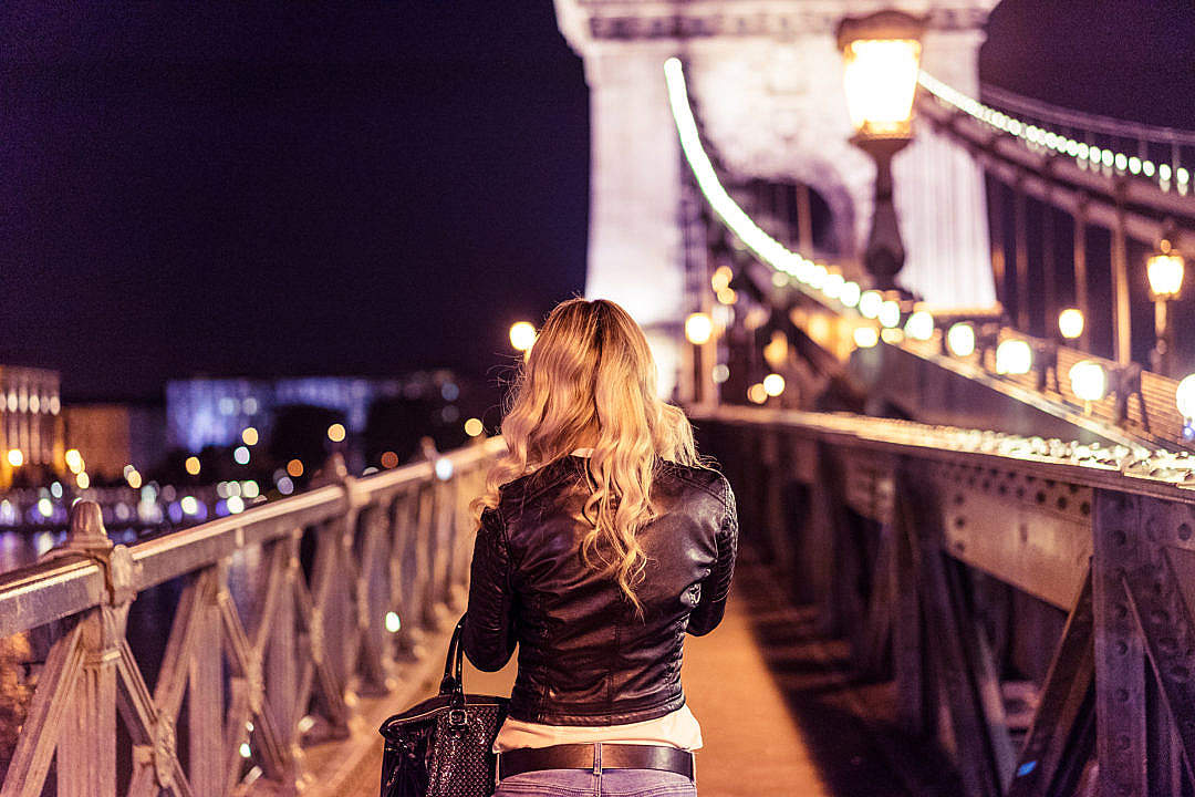 Download Blonde Girl Walking on Chain Bridge in Budapest FREE Stock Photo