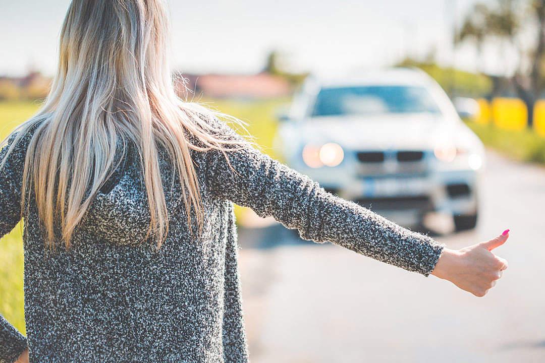 Download Blonde Woman Hitchhiking Because of Her Broken Car FREE Stock Photo