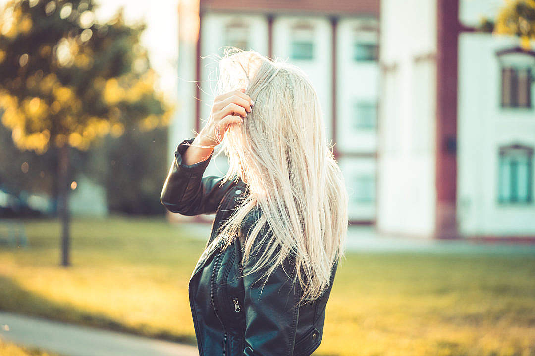 Download Blonde Woman Playing with Hair Against Sun FREE Stock Photo