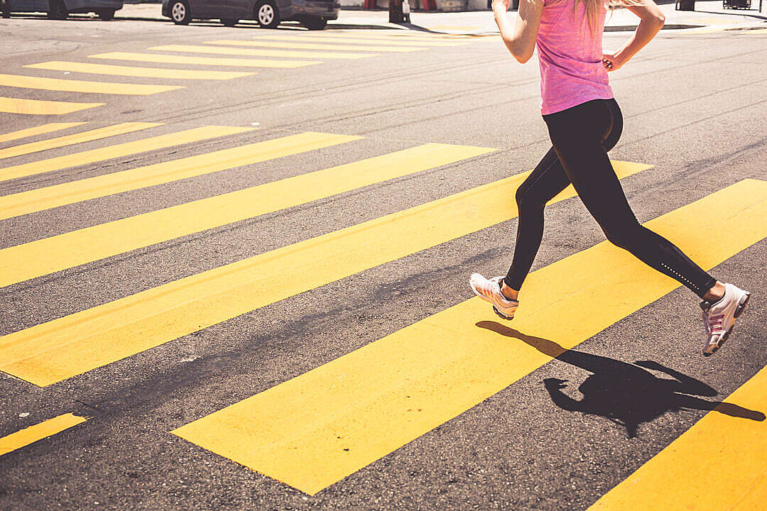 Download Blonde Woman Running Over The Pedestrian Crossing FREE Stock Photo