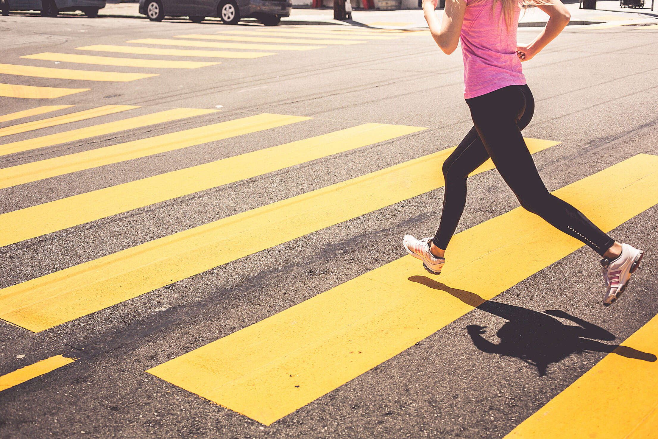 Blonde Woman Running Over The Pedestrian Crossing Free Stock Photo
