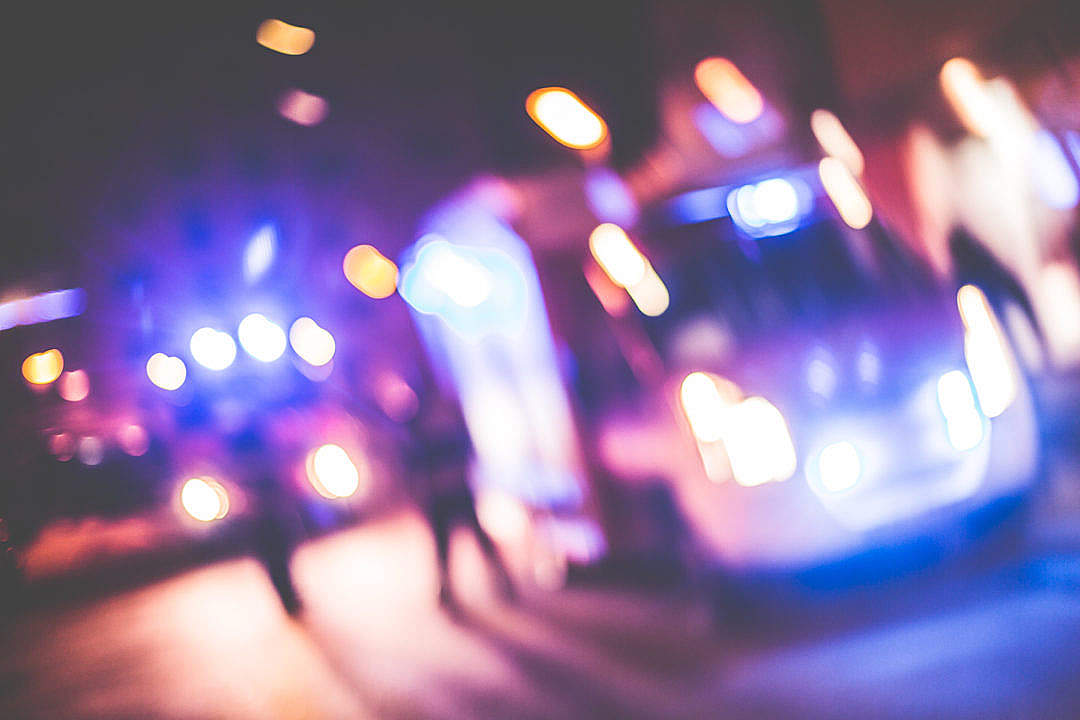 Download Blurred Emergency Cars At Night FREE Stock Photo