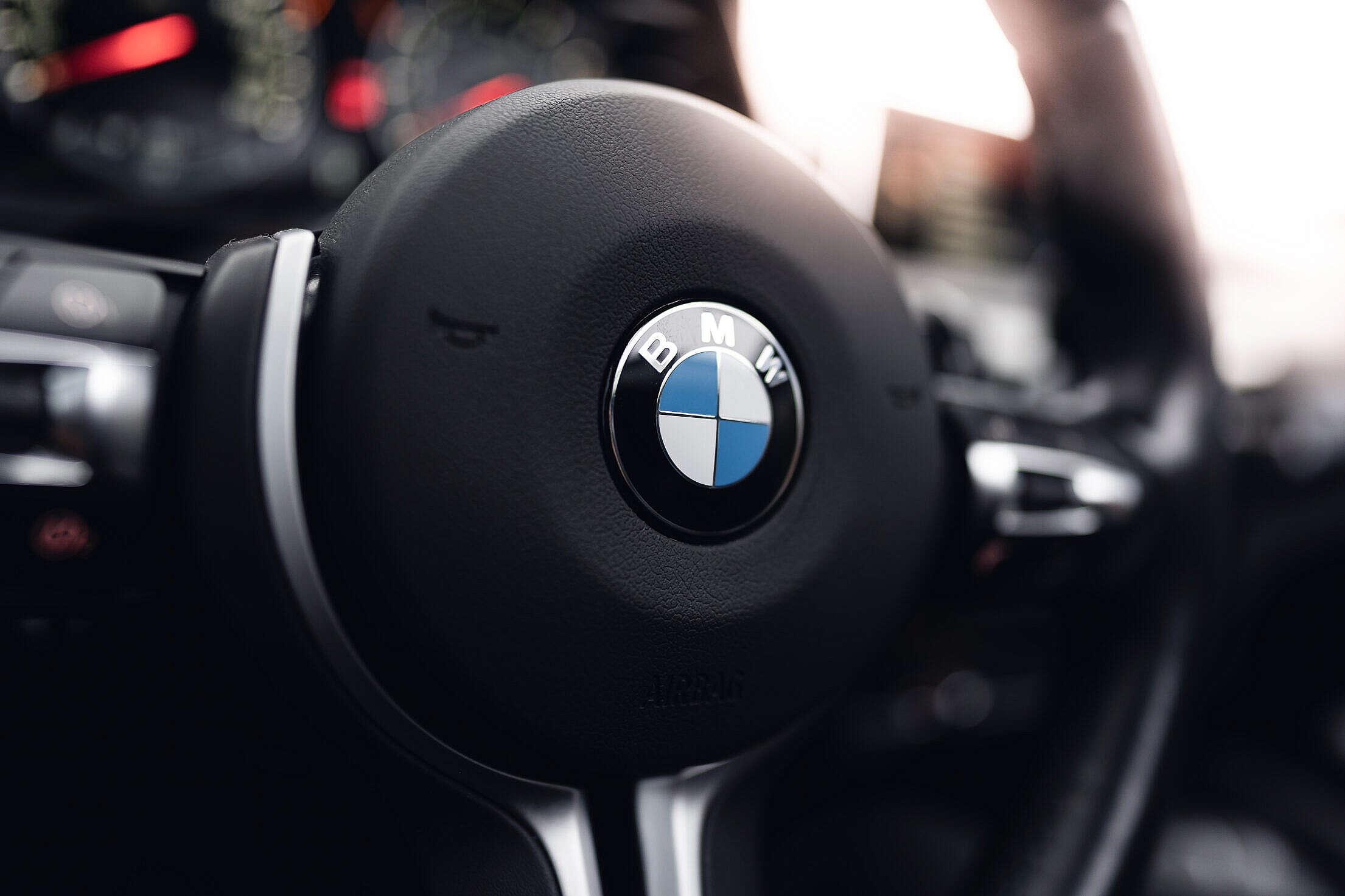BMW Logo on The Steering Wheel Free Stock Photo