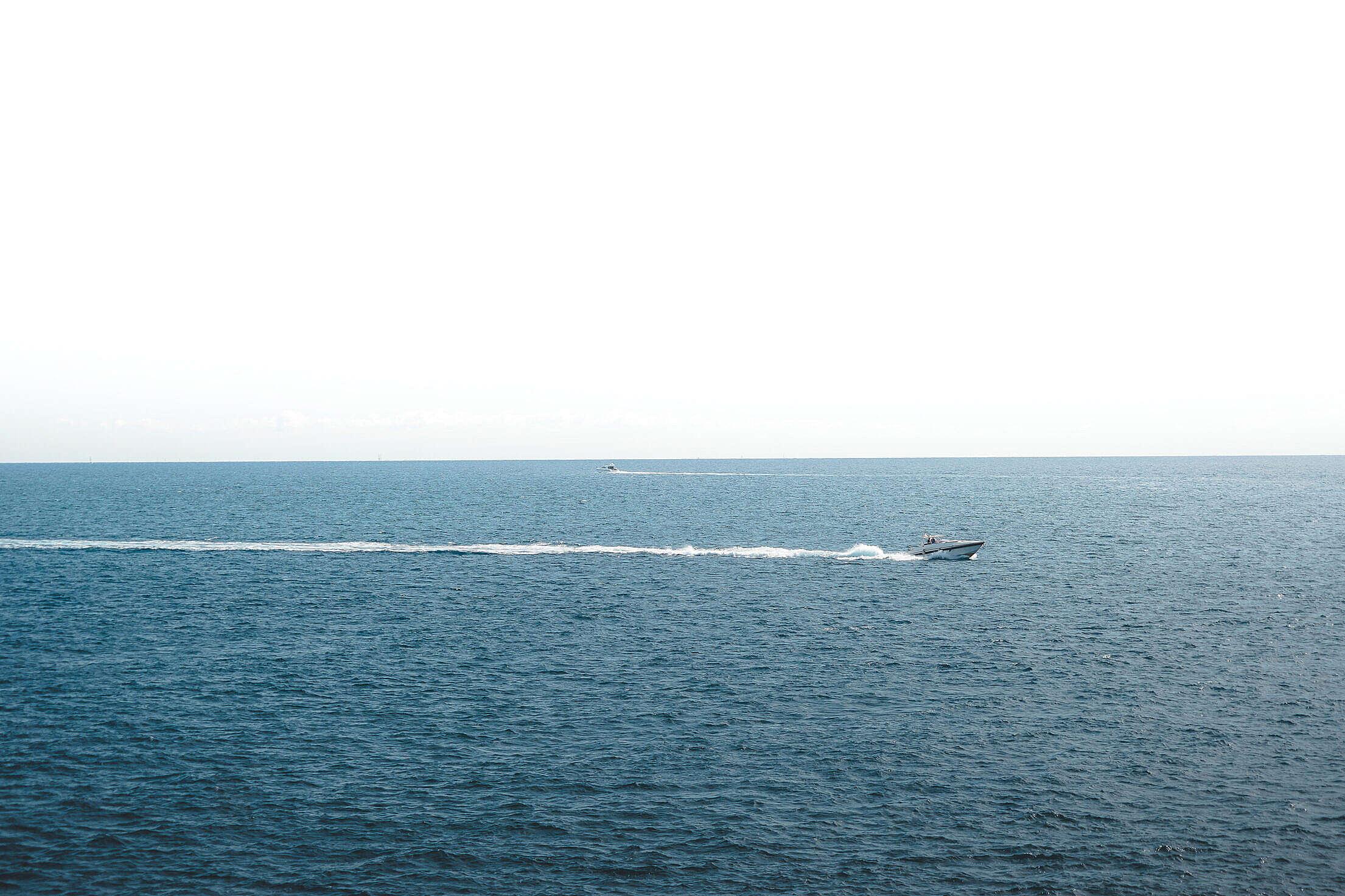 Boat at Sea Leaving a Wake Free Stock Photo