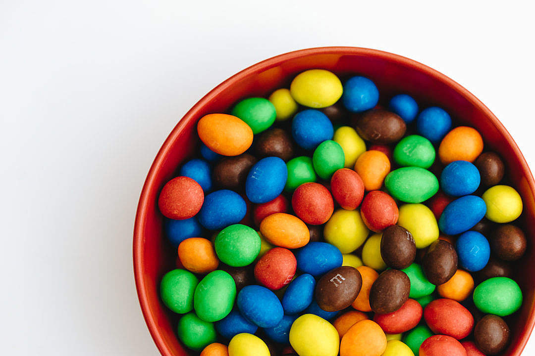 Download Bowl Full of Colorful Peanut Chocolates FREE Stock Photo
