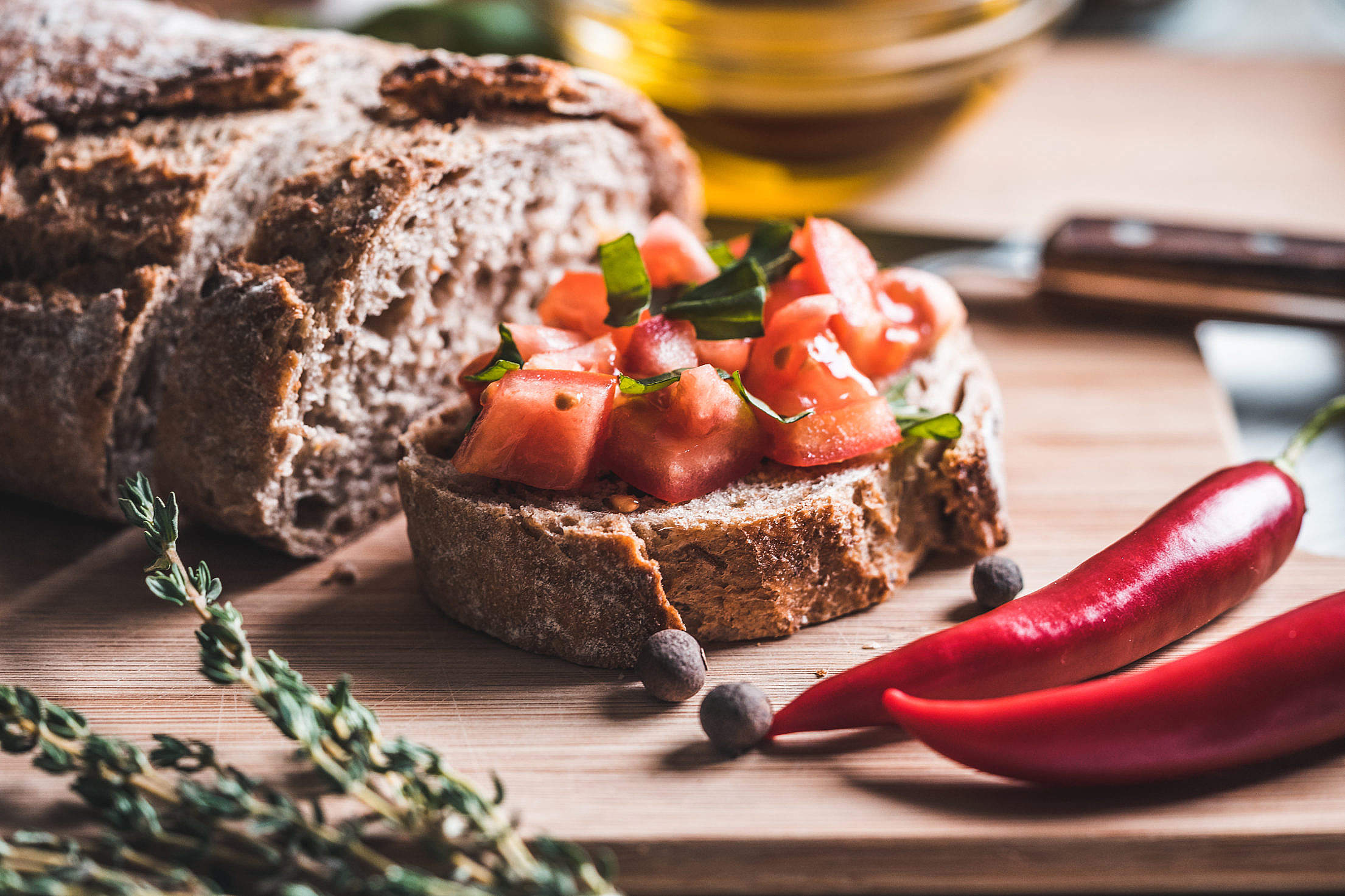 Bread with Tomatoes and Basil on The Chopping Board Free Stock Photo