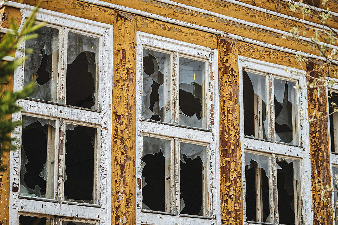 Download Broken Windows in an Old Abandoned Building FREE Stock Photo