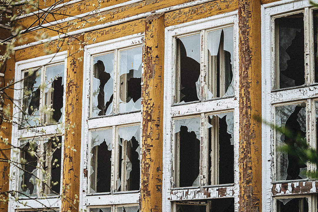 Download Broken Windows in an Old Dilapidated Building FREE Stock Photo