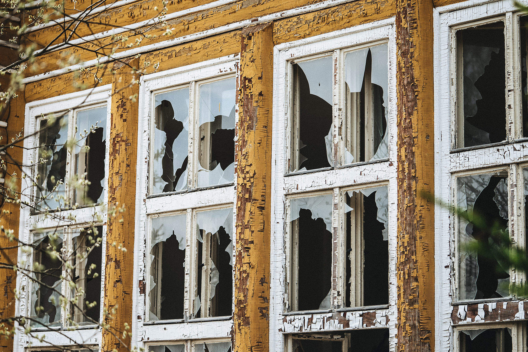 Broken Windows in an Old Dilapidated Building Free Stock Photo